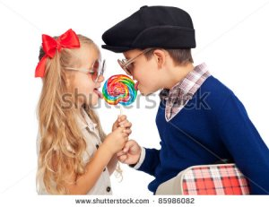 stock-photo-love-is-sharing-childhood-sweethearts-with-a-lollipop-and-vintage-clothes-85986082